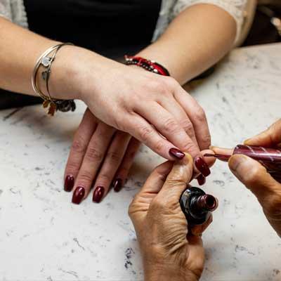 An Evolve Salon & Spa client receives nail services